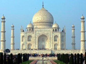 Tourists stand in front of the historic Taj Mahal in Agra